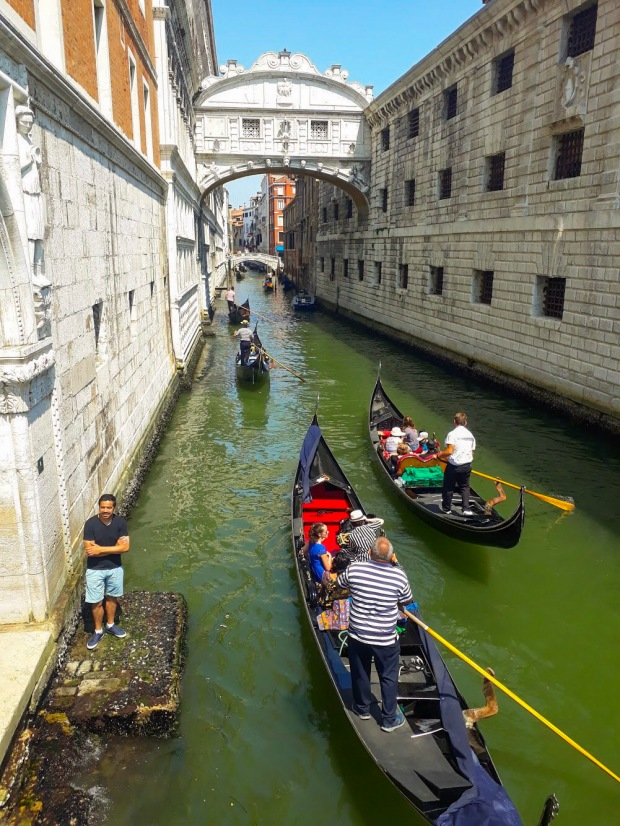Gondolas passing the Bridge of Sigh's in Venice, Italy