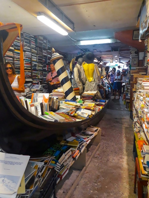 Gondola full of books in Acqua, Altra Liberia in Venice Italy